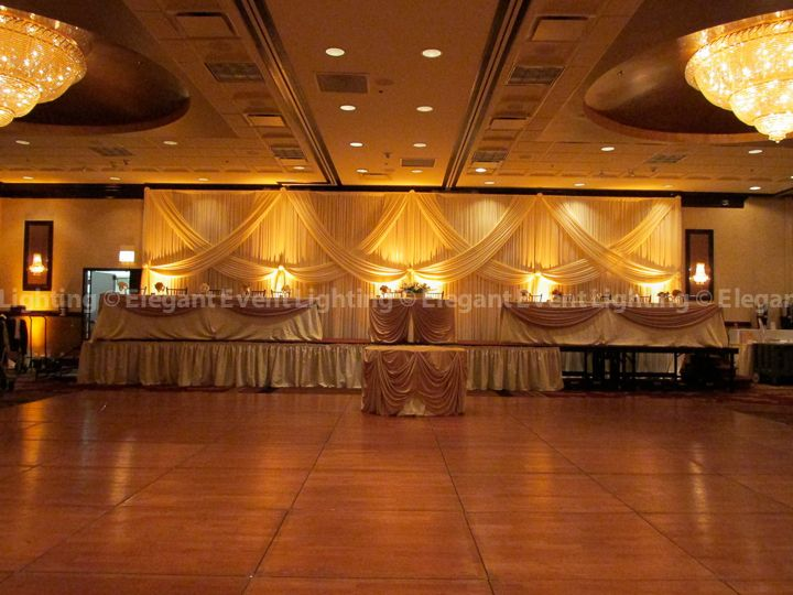 This Wedding Head Table Backdrop Transforms The Room Into A Warm Inviting Space