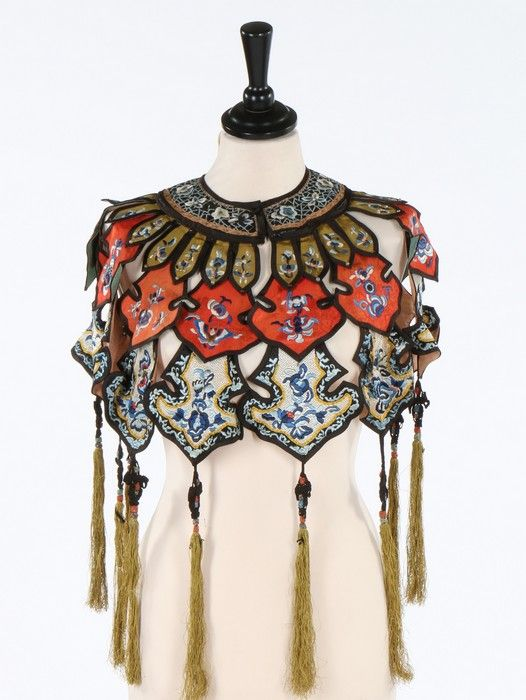 * embroidered cloud collar, Chinese early 20th century. formed from sage green, brick red and ivory diaper-embroidered tiers, with butterfly and floral motifs, trimmed with tassels; together with an embroidered silk mobile pendant, embroidered with tiny insects, floral slips, trimmed with fringes and beads