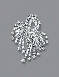 A DIAMOND BROOCH  The central twin scroll to brilliant and baguette-cut diamond sprays, each line with collet terminal, circa 1960,Brooch - $16,565 at auction