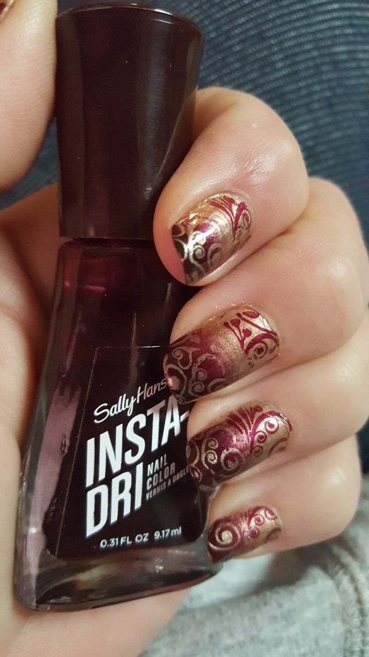 Fall nail art. Stamp art for nails.        Insta-Dri 403 Go Garnet and a gold polish two tone nails flipped color art design.