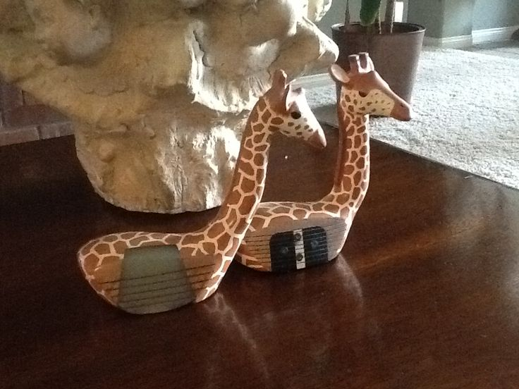Giraffes from wooden golf clubs.