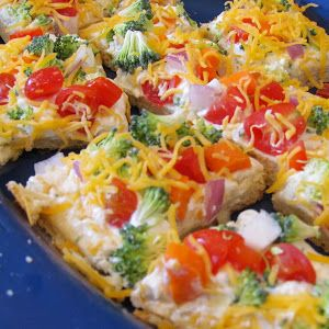 Appetizers: Veggie Pizza  2	pkgs Crescent Rolls OR 1 pkg of the large Crescent Roll sheet ¾	cup mayonaise 2	(8 oz. pgs) Cream Cheese, softened 1	Package of dry Hidden Valley Ranch DRESSING mix 4	cups of a variety of chopped raw vegetables of your choice (ex: broccoli, cauliflower, green pepper, onion, tomatoes, cucumbers, radishes) ½	cup sliced black olives (optional) 1	cup grated sharp cheddar cheese
