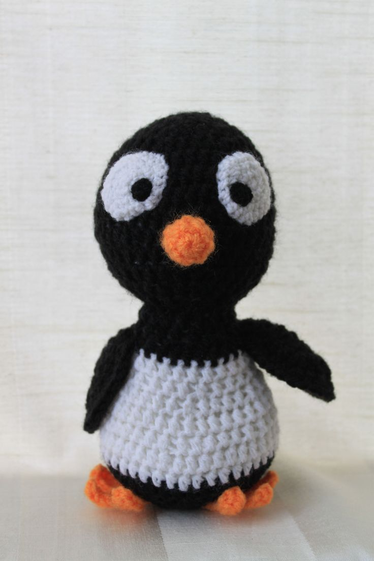Pam the penguin. Amigurumi plush animal. The animal is approximately 20 cm tall.