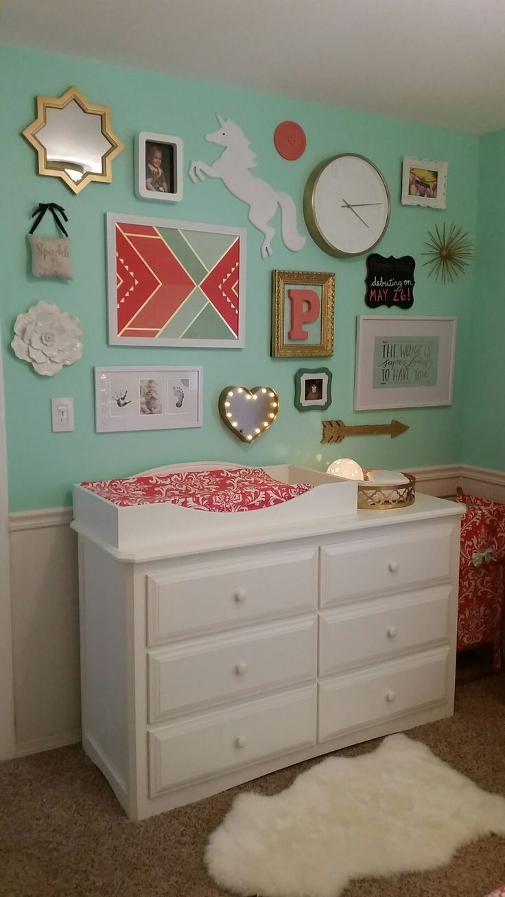 Coral, mint and gold baby girl nursery.   Collage wall: Target and Hobby Lobby; Rug: Pottery Barn; Dresser: Treasure Room's; Hamper and changing pad cover: BabyBeddingbyJBD (etsy)