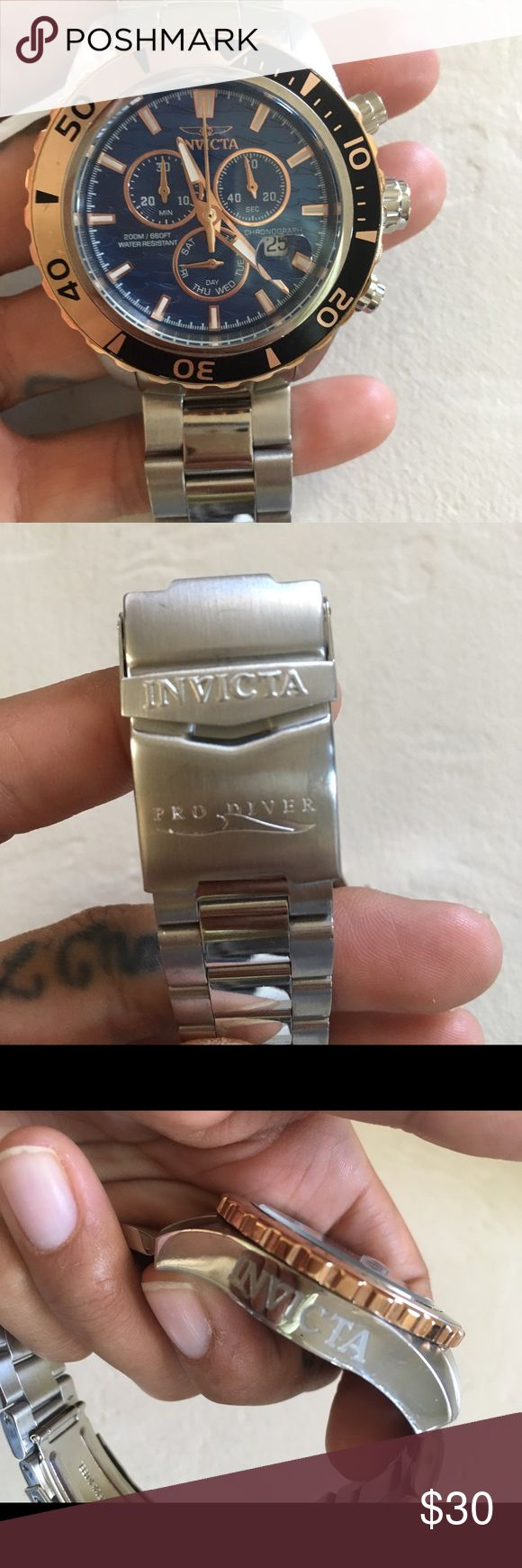 Men's Invicta Watch Men's Invicta Watch//Some signs of wear present, light scratches to face and band//Unsure if Watch works properly so selling for parts//No box//No battery Invicta Accessories Watches