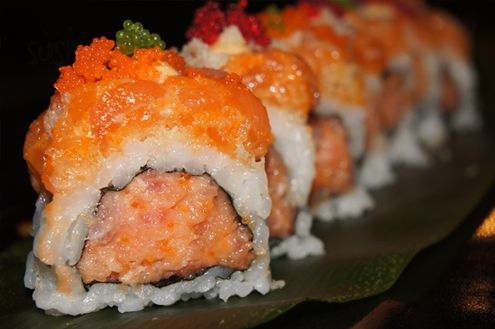 Orange Dragon Roll: mix of spicy tuna and tempura flakes inside and is topped with spicy salmon, tobiko and crunch tempura flakes.