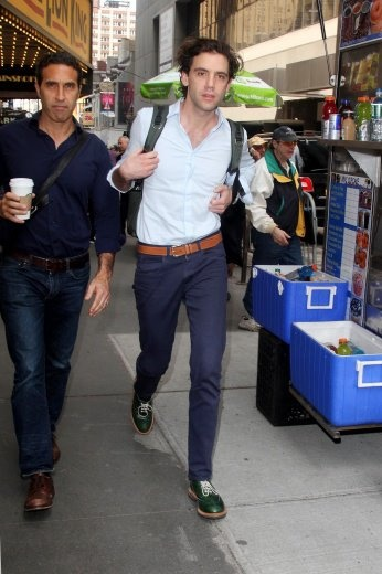 Mika walking with his manager