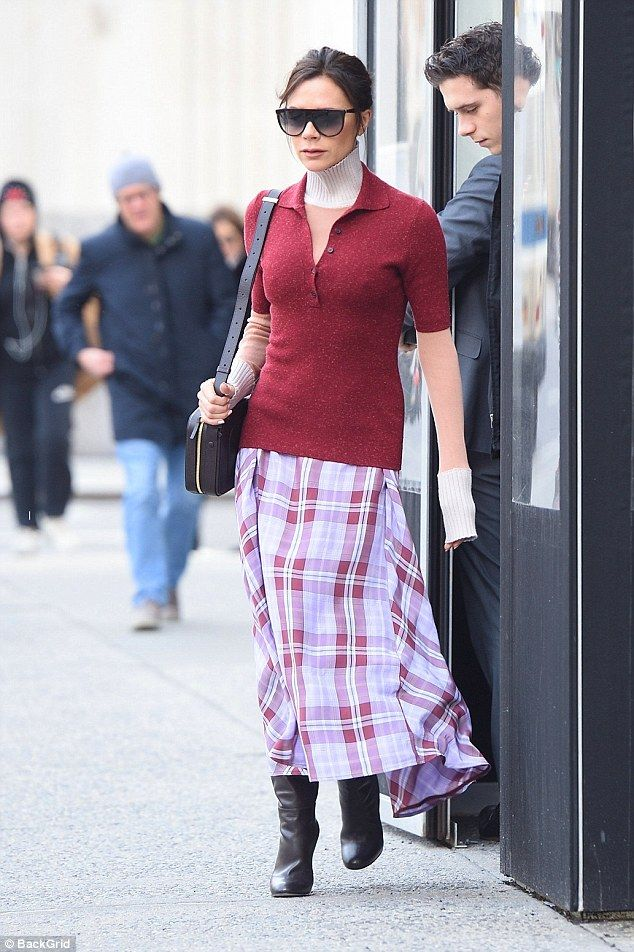 Check out Victoria in a check midi skirt from her own collection #DailyMail