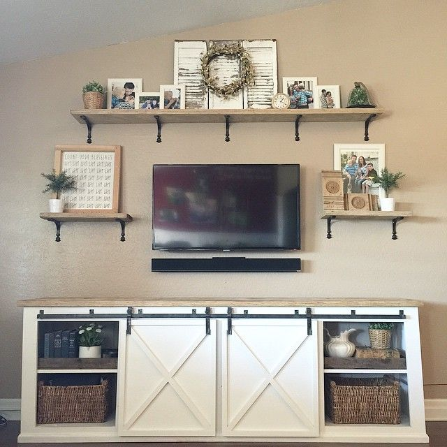 Here's the whole media wall I finished the other day for the Dosters. The sliding door media console I built for her was the perfect solution for her massive tv wall. And the brackets I found from @homedepot for the scaffolding plank shelves work so well with the door track.
