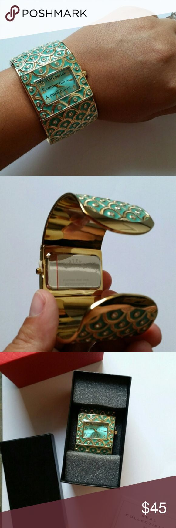 """NIB Real Collectables by Adrienne Cuff Watch Russian Easter Egg Inspired Jeweled Cuff Watch. Brand new in box.  Purchased a few years ago and just not my style anymore, forgotten in the back of my closet.  Beautiful green and gold scallops with jewel inlays 1.5"""" wide, because of the cuff will fit many size wrists Don't forget to bundle for a discount or make an offer  All items come from a non-smoking home! Real Collectibles by Adrienne Accessories Watches"""