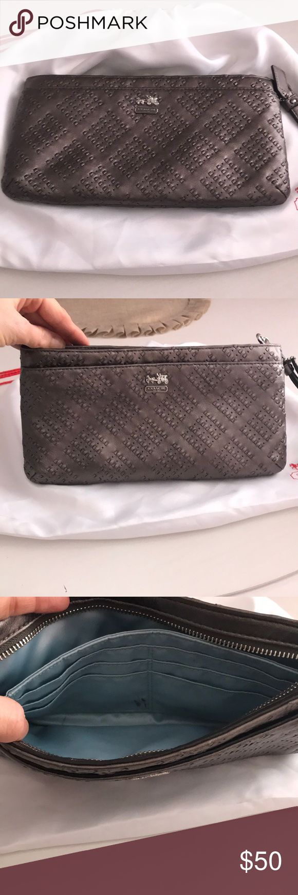 Authentic Coach Clutch/Wristlet Authentic Coach Wristlet. Dark Silver with light blue satin inside. The inside has wear and tear, some pen marks, etc. the outside is in excellent Condition. Coach Bags Clutches & Wristlets
