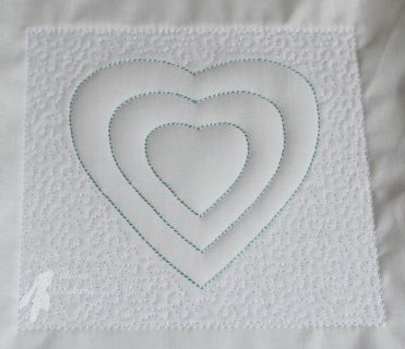 Trapunto Heart 5x5  Trapunto gives area's of a design a raised, puffy effect which is simple yet very effective. It is fun and easy to do all in the hoop.   Full instructions are included.  All the 5x5 trapunto quilt blocks can be mixed and matched so use as many or as few as you like.  You will end up with a 5x5 quilt block.  PES, JEF, VIP, VP3, XXX, HUS, EXP, DST formats.