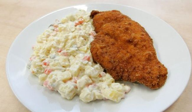 Fried carp with potato salad is a typical Christmas dinner in most Czech families. The recipe is already known from the times of Magdalena Dobromila Rettigová whose cookbook was first published in 1826. It is difficult to write a universal recipe for Czech potato salad, because it is unique in every family and often inherited. Besides fried carp is also part of the Christmas dinner of fish soup. 4 serves, preparation time 1.5 hour + 1.5 hour for maturing the salad Ingredients: Carp: 800 g…