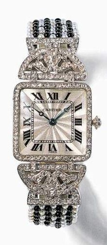 Art Deco platinum, onyx, and diamond watch by Cartier, circa 1912
