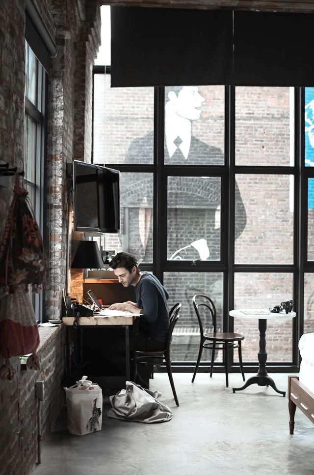 Windows and exposed brick walls.  Love.  I'd have rugs like crazy because you know that floor would be cold!