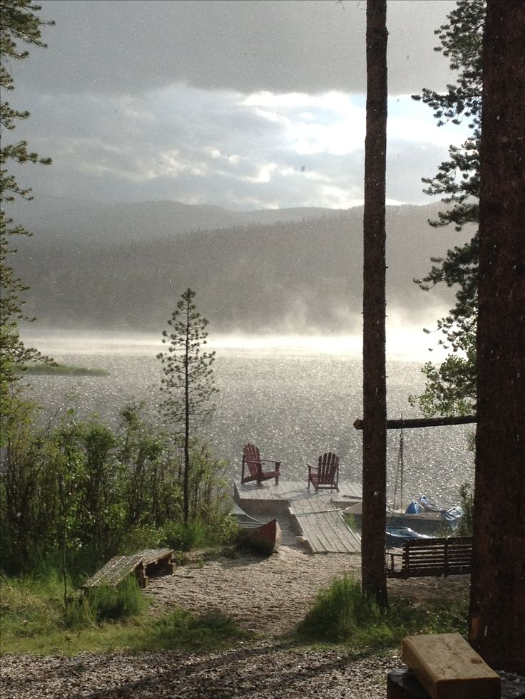 View of dock and sun breaking through mountain rainstorm at lakeside log cabin. Twin Pines Lodge, Grand Lake, Colorado. VRBO.com/392971