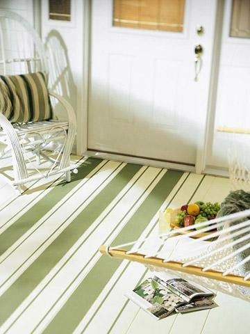 Looking up        Brush on paint to update an old wood or vinyl floor. Here, a porch wears charming stripes.