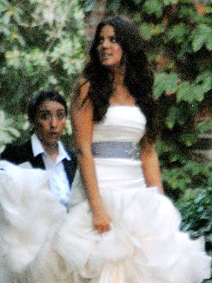 Khloe Kardashian's Wedding Dress..? What about that girls face in the background?!