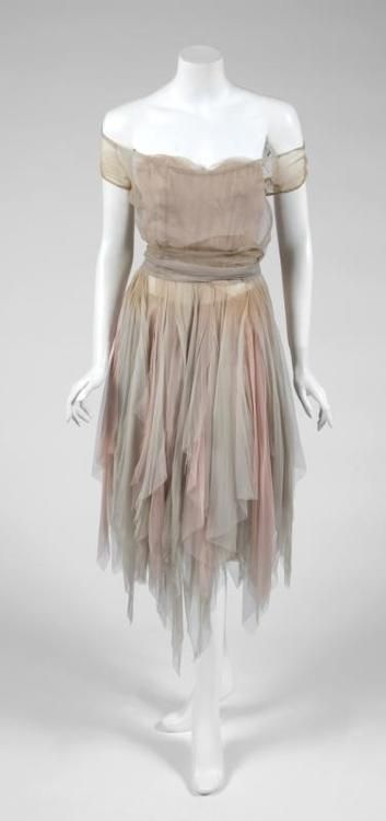 Julien's Auctions: A pastel chiffon rag dress worn by Leslie Caron in the Cinderella tale The  Glass  Slipper  (MGM, 1955). The costume has a fitted boned bodice and an intentionally tattered skirt formed from layers of torn chiffon in pale grey and pink.