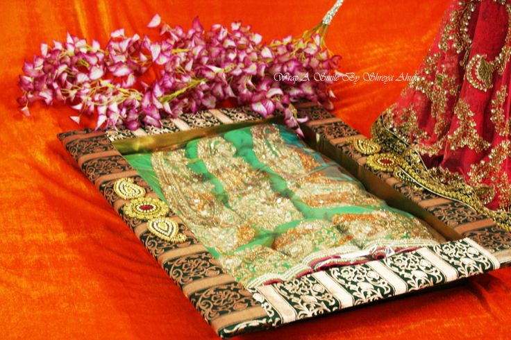 Trousseau Packing At https://www.facebook.com/WrapASmile Cooper & Green Brocade Customized Tray for Sarees, Lehengas, heavy dresses ! Shapes, Sizes & Colors can be customized as per choice ! For inquiries drop me an email on wrapp.a.smile@gmail.com or leave us an inbox on facebook ! Follow us on Facebook -https://www.facebook.com/WrapASmile Instagram - wrapasmile/ahujashreya