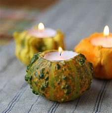 Carve out the top of a tiny pumpkin to use as a tealight holder!