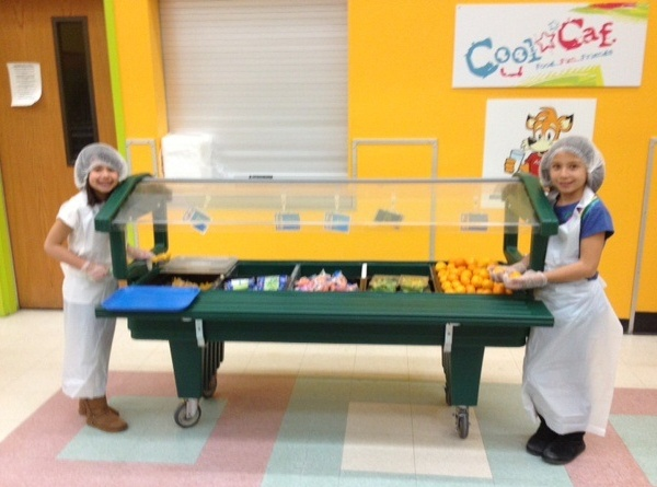 Students at Washoe County School District in Nevada show off the delicious fruits and vegetables at their school's salad bar.