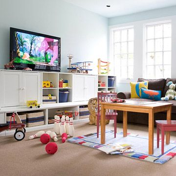 Family Space     Make your entertainment center work as hard as you do. This modular system of shelves and cabinets keeps toys and games in plain sight while concealing media components behind the cabinet doors. The TV sits nicely on top, visible from all corners of the room