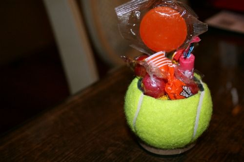 Tennis ball filled with candies as party favors.