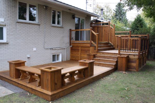 tri-level deck with benches and garden boxes http://www.patios-clotures.com/en/
