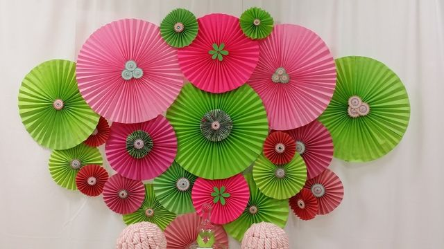 Love this paper medallion backdrop at a Pink and green Baby Shower!  See more party ideas at CatchMyParty.com!  #partyideas #babyshower