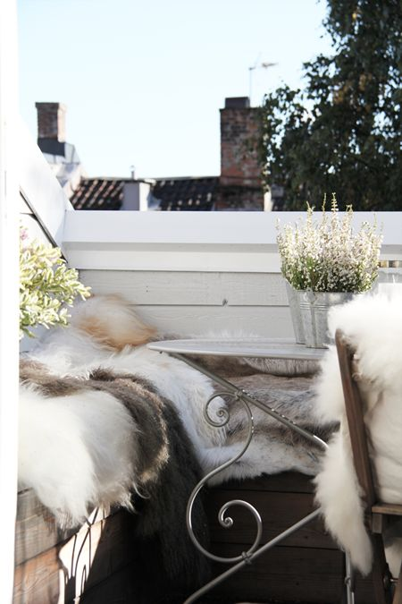 In the colder months, cozy up your outdoor space with warm furs and throws.