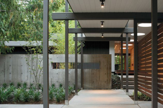"""Slatted wood wall for privacy yet open, twisting path. Long """"window"""" in the concrete wall. Structured, rectangular panting beds. Even spacing steel? (painted wood?) supports. Dislike the ceiling material. The Woodway Residence by Bohlin Cywinski Jackson, Contemporist, http://www.contemporist.com/2008/11/27/the-woodway-residence-by-bohlin-cywinski-jackson/#"""