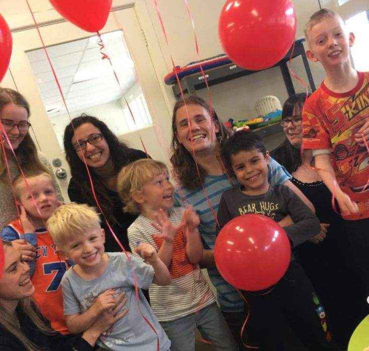 Kids and adults at the NDIS Provider of the Year 2016 celebrate with red balloons