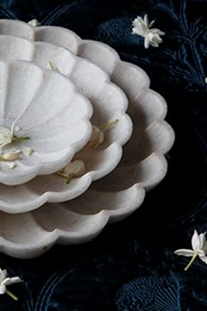 Set of elegant marigold white marble plates, ideal to keep accessories available online at goodearth.in