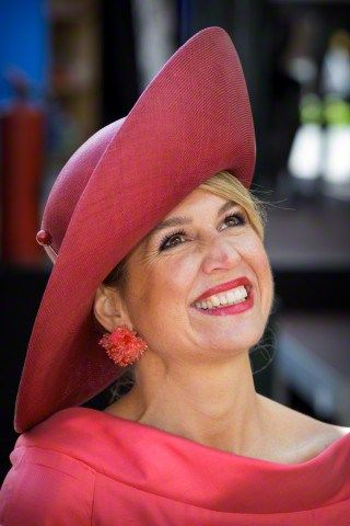 Queen Máxima, April 27 in Fabienne Delvgine | Royal Hats: Queen Máxima unveiled a new hat for today's celebration. In vibrant pink straw, the large brimmed picture hat featured a sharply upfolded 'slice' brim and was trimmed simply with a darker raspberry ribbon around the crown.