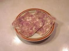 Hog Head Cheese a.k.a Souse Not for the sqeamish! Its so delish with crackers, my grandma used to make it :)