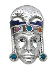 Peru | Silve 950 and semi precious Stones                Pendant of South American's craft, depicting the mask of the 'Lord of Sipàn'.  Made of embossed Silver, it is decorated with inlaid Mother of Pearl, Peruvian Turquoise and Spiney Oyster shell that reproduce the pattern of the crown of this powerful aristocrat.  In 1987 in a village near Chiclayo, Peruvian city in the Norte region, in the archeological site of Sipàn was found the ...