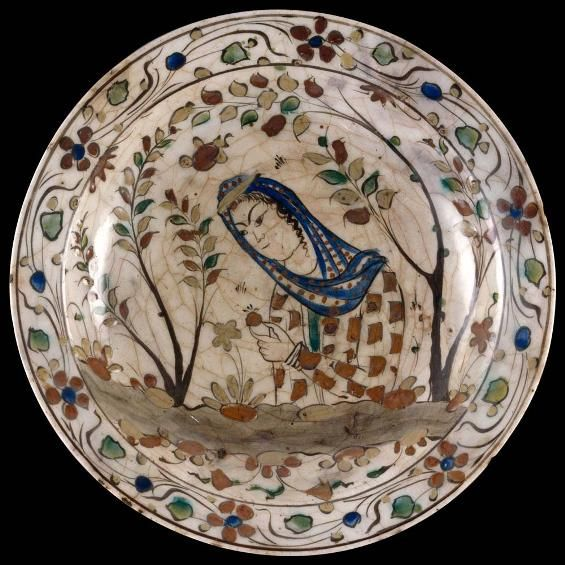 Dish decorated with a young woman Iran, Isfahan (?), late 16th century to early 17th century Stonepaste with overslip painted decoration under a transparent glaze H. 6 cm; Diam. 33 cm; Base Diam. 14.5 cm Musée du Louvre, Musée des Arts décoratifs deposit,