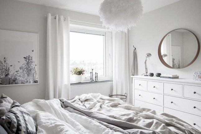 White bedroom with Ikea 'Hemnes' dressers & 'Stockholm' mirror