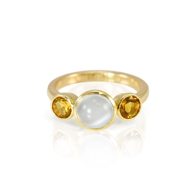Carmen Moonstone Ring with Citrines  Hand-made tapered tube in 9 carat yellow gold with 2 faceted citrines (5 mm) and a central round Moonstone cabochon (7 mm).