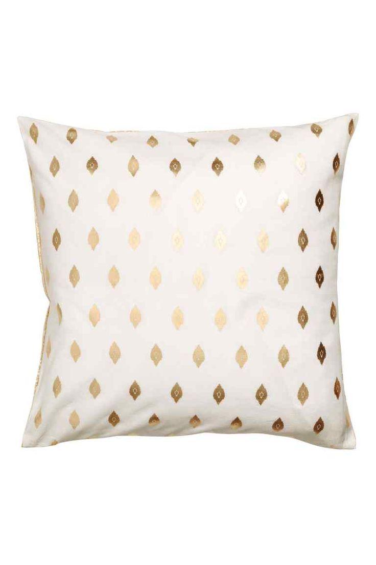 Чехол на подушку с рисунком: Чехол на подушку из хлопка с разным золотистым рисунком на передней и задней стороне. Потайная молния.