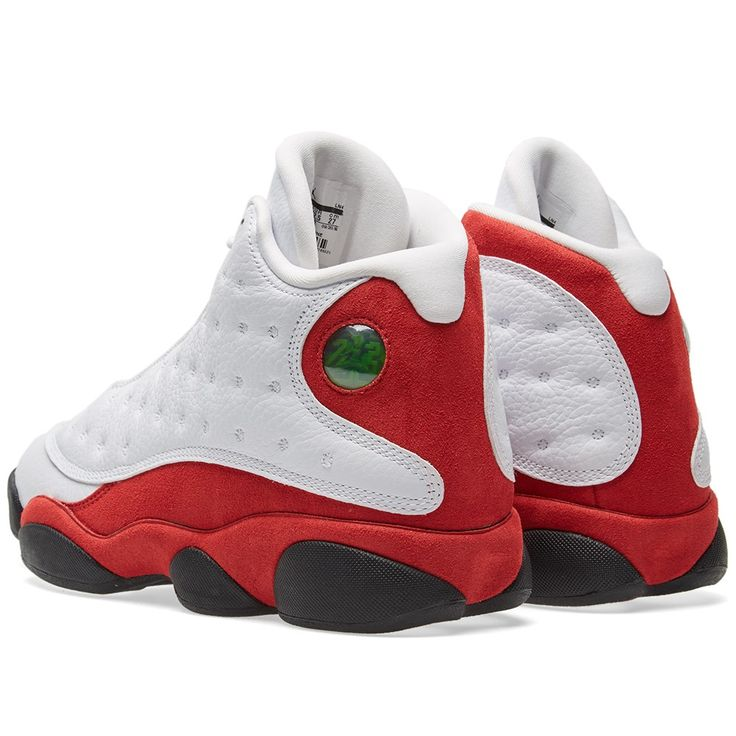 Nike reissue a true classic in the guise of the Air Jordan 13 retro. Delivering the signature 'Bulls' colourway, this iteration boasts plush red suede panelling to the heel and midsole with opulent white leather uppers, perforated tongue and finished off with an iridescent heel decal and Jumpman logo embroidered to the tongue  Premium Leather Uppers Suede Panelling 'Bulls' Colourway Carbon Fibre Jumpman Sole Jewel Style Code: 414571-122