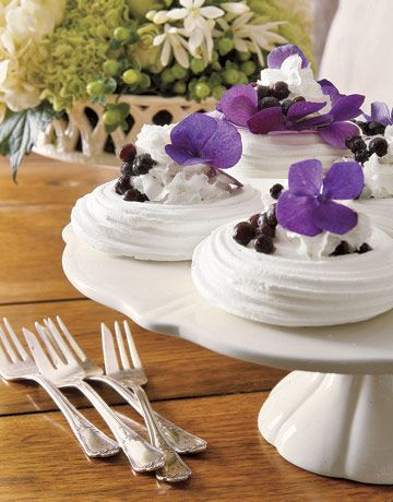 Cream-Filled Meringues    For a beautiful and light dessert, garnish whipped-cream-filled meringues with blueberries and violets, an edible flower.