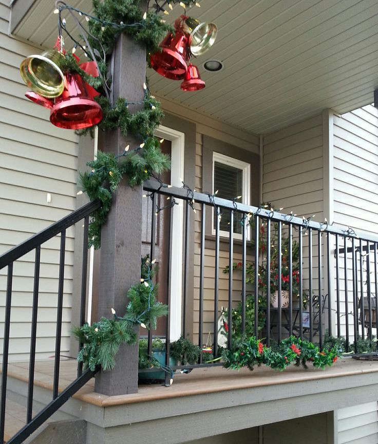 My new Christmas bells on the porch. I bought 3 sets, different sizes from Walmart & Canadian tire, took them apart and made 2 sets with 3 sized bells in each to hang from my plant hangers.  www.christinelindsay.org
