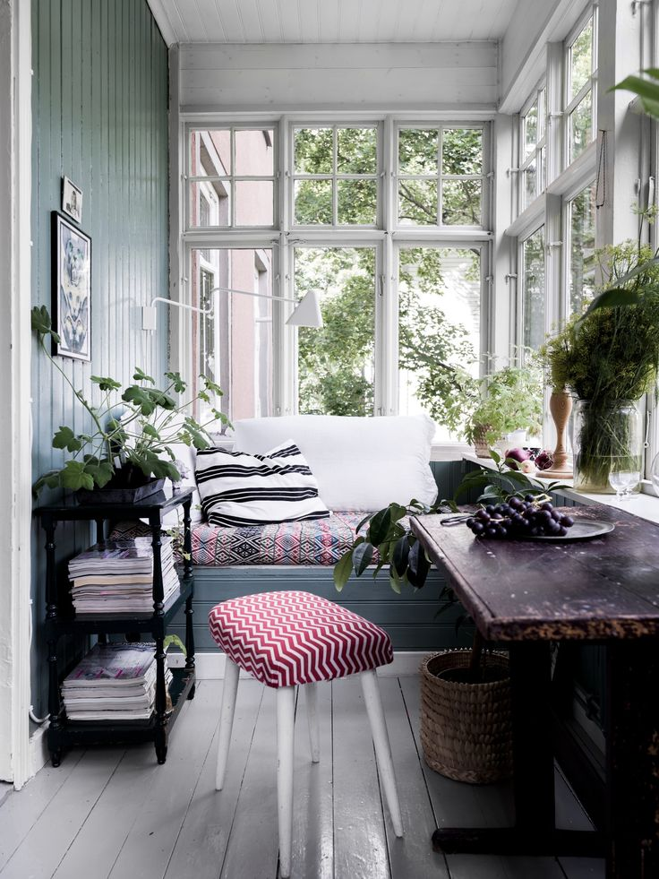 Cozy vintage looking workspace with window seat