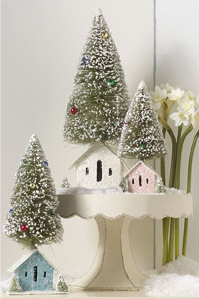 Oh, I love this Christmas village! With little glittered houses and bottle brush trees, it's great for a decoration and a child's imagination!