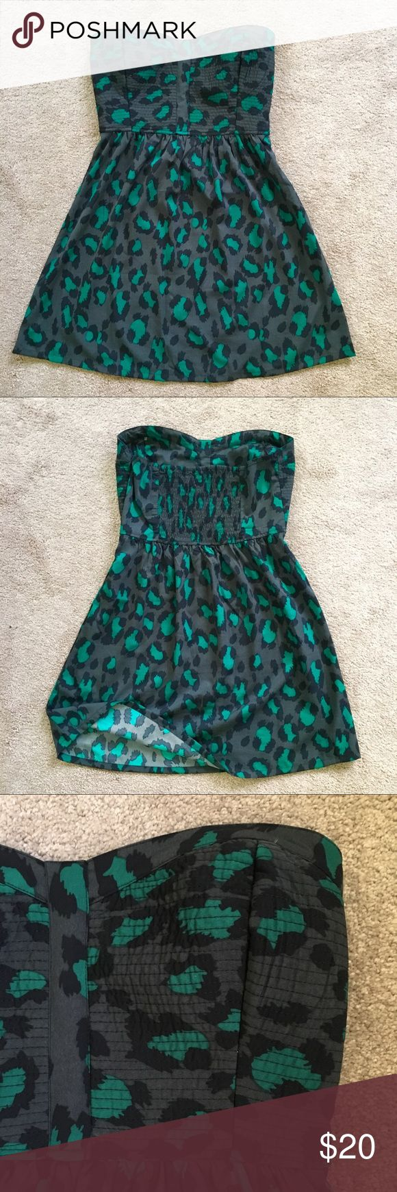 Hurley Animal Print Strapless Dress Fun dress that looks great with heels to go out or flip flops for a beach day. A line shape with length stopping just above the knee. Bust is roomy and has an elastic band at the back for some stretch and comfort. Hurley Dresses Strapless