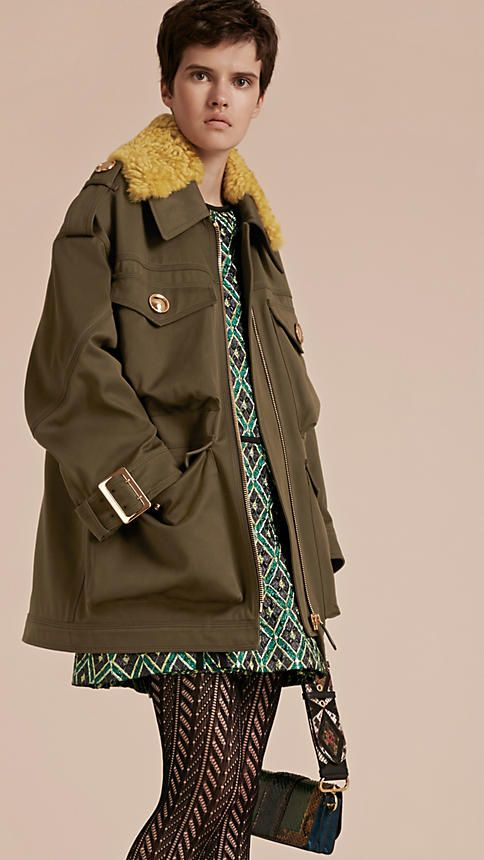 A four-pocket military field jacket in hardwearing cotton from Burberry. The off-duty piece is updated with a detachable shearling collar. Large polished buttons salute original army designs.