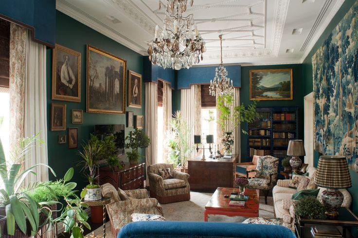"Russian designer Kirill Istomin carefully layered in furniture and objets to give a 1990s-built home outside Moscow a sense of history. ""Although this room might look busy, color wise it's rather monochromatic,"" he said. He built the palette of beige, green-blue and brown around the large, French 18th-century tapestry."
