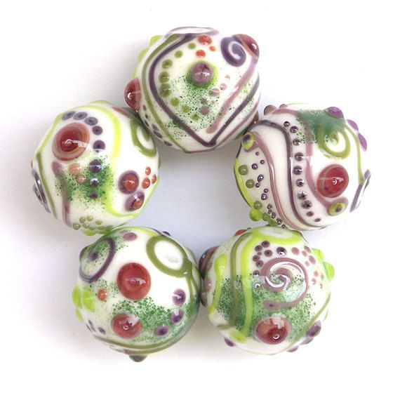 snow white round lampwork glass bead set in white purple red and green